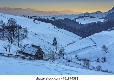 Sunrise over snowy Transylvanian lands in Rucar-Bran pass, Romania.