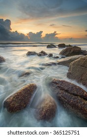 Sunrise Over South China Sea with Beautiful Waves Movement. Taken with Slow Shutter, Soft Focus and Motion Blur of Wave. Copy Space Area