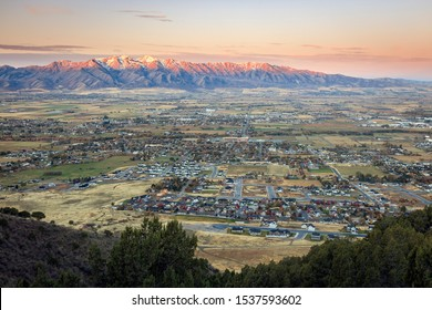 Sunrise over the town of Millville in Cache Valley, Utah, USA.