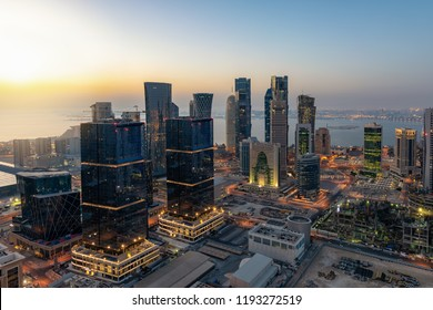Sunrise over the urban skyline of Doha, the city center Westbay with the modern skyscrapers, Qatar