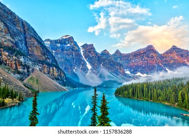 Sunrise over the Valley of the Ten Peaks with glacier-fed Moraine Lake in the foreground in the Canadian Rockies.