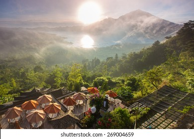 Sunrise over the valley with villages and lake situated in caldera of old giant volcano. Bali, Indonesia