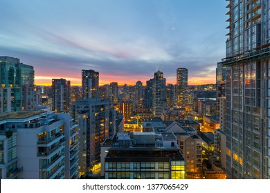 Sunrise over Vancouver BC British Canada downtown residential condomiums cityscape at dawn