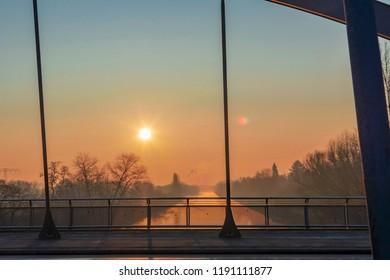 """Sunrise over the waterway """"Teltowkanal"""" in Berlin, Germany on a misty morning."""