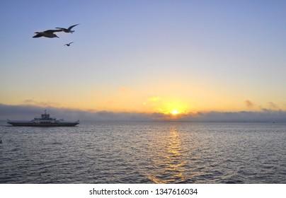 Sunrise over Yalova. Travelling by ferry boat from Istanbul to Yalova.