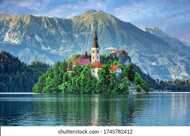 Sunrise ower Bled Lake, Island, Church And Castle With Mountain Range (Stol, Vrtaca, Begunjscica) In The Background-Bled, Slovenia - Shutterstock ID 1745782412