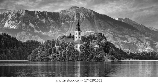 Sunrise ower Bled Lake, Island, Church And Castle With Mountain Range (Stol, Vrtaca, Begunjscica) In The Background-Bled, Slovenia