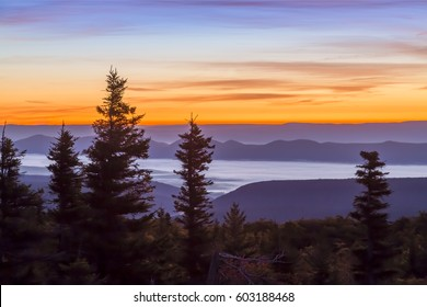 Sunrise paints the morning sky and mountain landscape over the Allegheny Front as viewed from Bear Rocks at the Dolly Sods Wilderness of West Virginia.