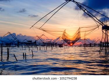 Sunrise at Pak Pra lake, Pattalung, Thailand,silhouette of tradi