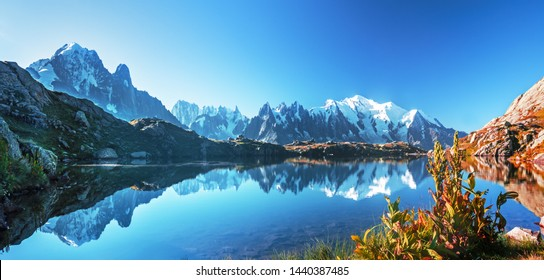Sunrise  panorama of the Lac Blanc lake with Mont Blanc (Monte Bianco) on background, Chamonix location. Beautiful outdoor scene in Vallon de Berard Nature Reserve, France
