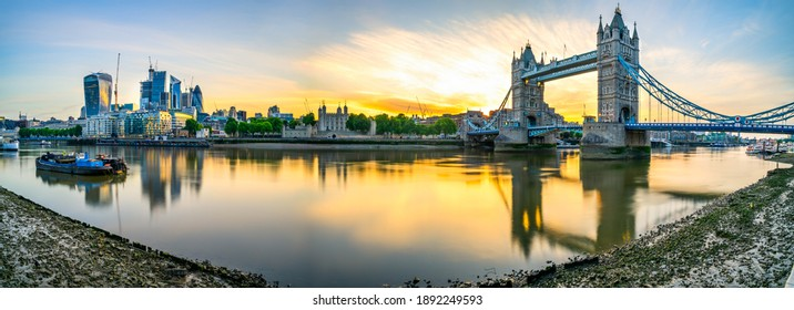 Sunrise panorama of Tower Bridge and financial district in London, England