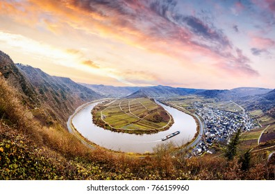 Sunrise panorama View from the mountain at the river Mosel by Moselschleife in Bremm a small village alongside the Mosel river, Germany