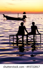 sunrise people boat  and water in thailand kho tao bay coastline south china sea