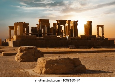 Sunrise in Persepolis, capital of the ancient Achaemenid kingdom. Ancient columns. Sight of Iran. Ancient Persia. Sunrise background.