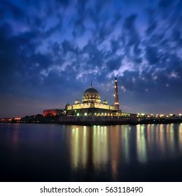 Sunrise at Petrajaya Muslim Mosque in Kuala Lumpur Malaysia.Image has grain , noise and soft focus ( long exposure photography)