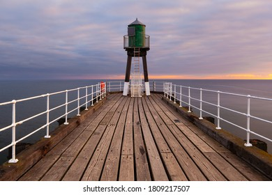 Sunrise at the pier of Whitby