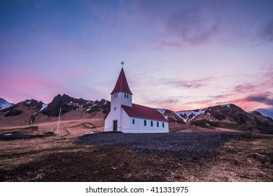 Sunrise (Pink and purple sky) at Vik city's Church in Iceland