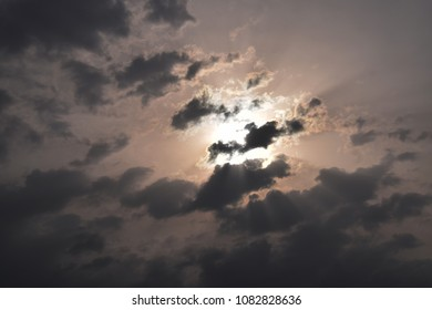Sunrise with rays behind the cloud