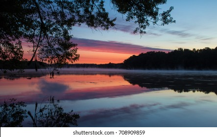 Sunrise reflected on the Connecticut River in Windsor Locks, CT