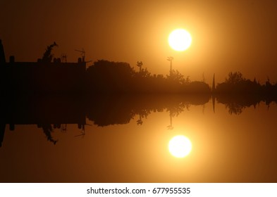 Sunrise with reflected sun, peace, calm, serenity, harmony, fullness, well-being, nature, natural, contemplate, meditate, breathe, grow,happiness, tranquility, fulfillment, integration,equilibrium,