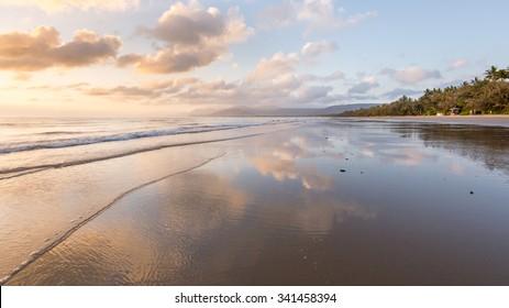 Sunrise reflection at Four Mile Beach at Port Douglas, Queensland, Australia.