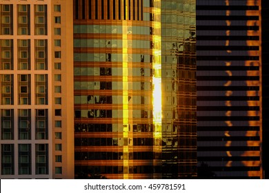 Sunrise reflections on the glass and steel skyscrapers in the central business district of Brisbane, Queensland, Australia