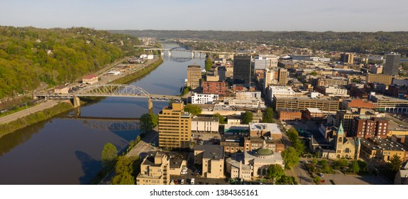Sunrise reflects in the Kanawha River slowly flowing by picturesque Charleston West Virginia downtown