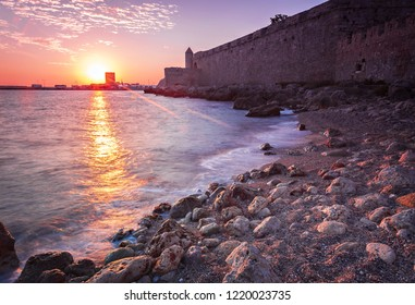 Sunrise in Rhodes town, by the old town wall.