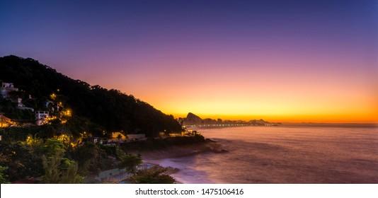 Sunrise in Rio, capturing Ipanema Beach, the town of Leblon and Sugarloaf Mountain.