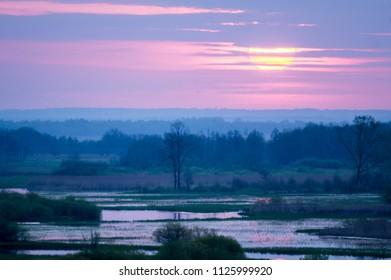 Sunrise with a river landscape
