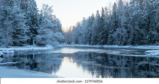 Sunrise river in winter. Farnebofjarden national park in Sweden.
