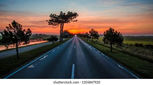 Sunrise road in Ameland Holland island