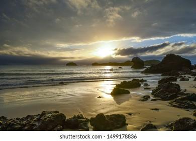 Sunrise with rocks and sea in Australia