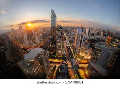sunrise rooftop view Three spear road to city, office buildings, living, condominium in Bangkok city skyline top view Downtown and business office bank financial in capital city of Thailand Asian