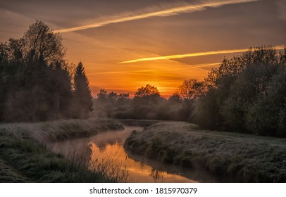 Sunrise rural river fog landscape. Morning sunrise fog over rural river. Rural river sunrise fog landscape. Sunrise fog landscape