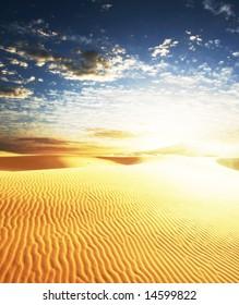 Sunrise in sand desert
