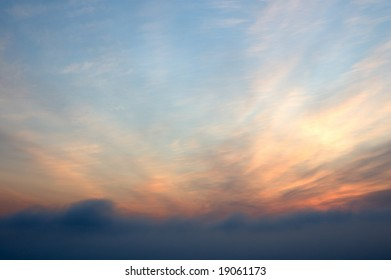 Sunrise scarlet sky with clouds - abstract background.