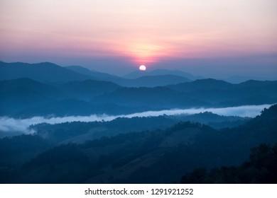Sunrise scene behind Mountain range in Thailand on background