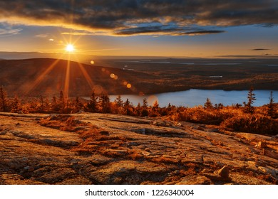 Sunrise scene from the Blue Hill Overlook of Cadillac Mountain in Acadia National Park, Maine (USA). HDR composite from multiple exposures.