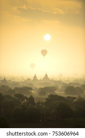 Sunrise scene hot air balloons fly over pagoda ancient city field in Bagan Myanmar. (High image quality)