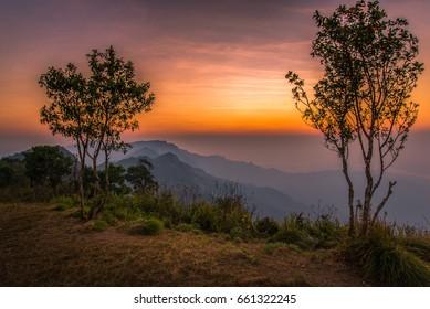 Sunrise scene with the peak of mountain at Phu chi fa in Chiangrai, Thailand.