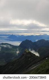 Sunrise scene seen from Mount Brienzer Rothorn. View towards Stanserhorn and Lucerne. Fog lifting slowly after a rainy night.