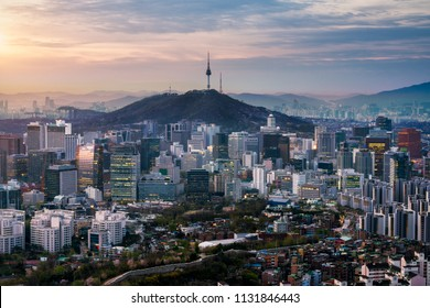 Sunrise scene of Seoul downtown city skyline, Aerial view of N Seoul Tower at Namsan Park in twilight sky in morning. The best viewpoint and trekking from inwangsan mountain in Seoul city, South Korea
