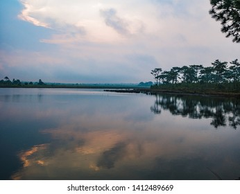 Sunrise Scenery view at reservoir on Phu Kradueng mountain national park in Loei City Thailand.Phu Kradueng mountain national park the famous Travel destination