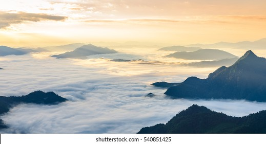 "Sunrise and sea of mist, view from phucheefa forest park mountain at Phucheefa,Chiangrai province ,North of Thailand. "" THE PEAK OF MOUTAIN POINT TO THE SKY """