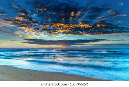 Sunrise Seascape with Clouds -  Capturing the sunrise from Wamberal on the Central Coast, NSW, Australia.