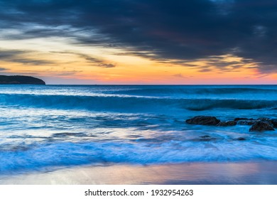 Sunrise seascape with clouds from Killcare Beach on the Central Coast, NSW, Australia.