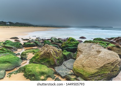 Sunrise Seascape with Green Mossy Rocks - Killcare Beach on the Central Coast, NSW, Australia.