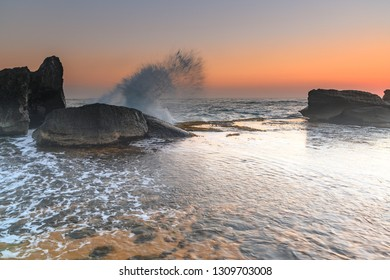Sunrise Seascape with Rocks - from Forresters Beach on the Central Coast, NSW, Australia.