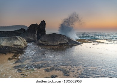 Sunrise Seascape, Splash and Rocks - Forresters Beach on the Central Coast, NSW, Australia.